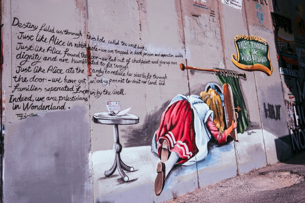 Alice in Wonderland painting on wall at Bethlehem by Taqi Spateen